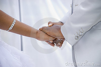 Holding Hands at their Wedding