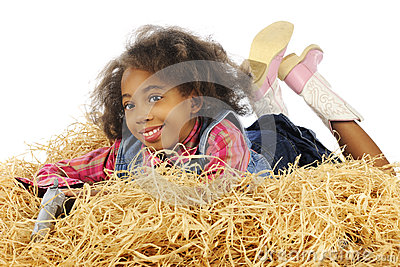 Holding Her Gun in the Hay
