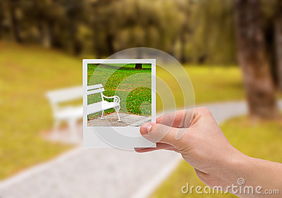 Holding Instant photo.