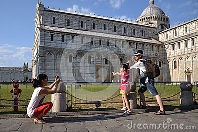 Holding the Leaning tower of Pisa Editorial Image