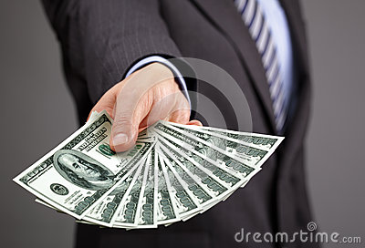 Holding one hundred dollar bills