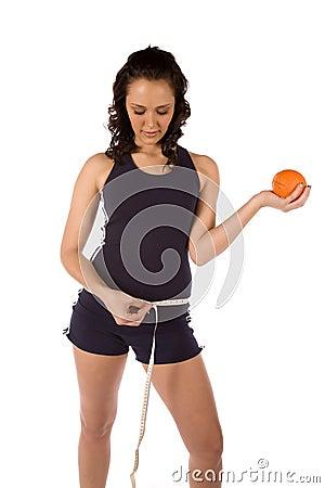 Holding orange measuring