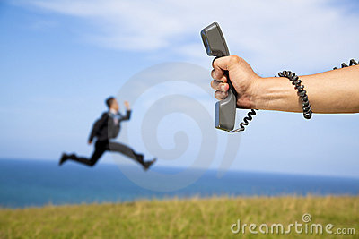 holding phone and businessman running
