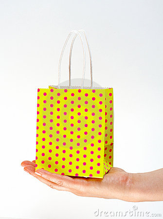 Holding shopping yellow bag
