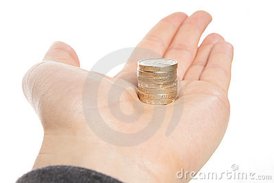 Holding a stack of one pound coins
