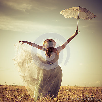 Free Holding White Lace Umbrella Beautiful Blond Young Woman Wearing Long Blue Ball Dress And Leaning Up On Wheat Field Stock Photography - 42189502