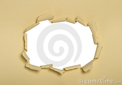 A hole punched into cream paper