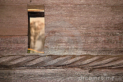 Hole in wooden wall