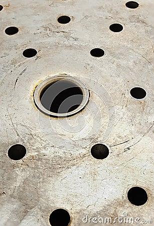 Holes in metal.
