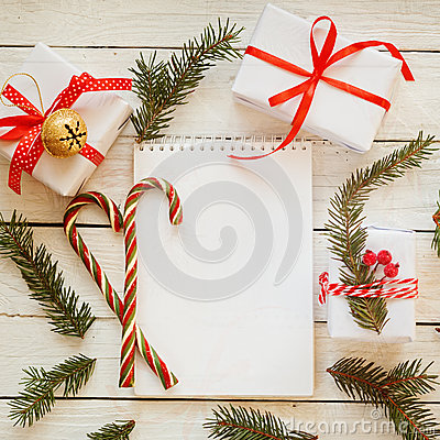 Free Holiday Decor Notebook For Message With Gift, Present Box And Candy Cane. Christmas Background. Top View Royalty Free Stock Photography - 81895627