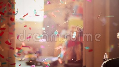 Holiday firecracker at home. Woman blows up holiday paper cracker at home. Slow motion stock video
