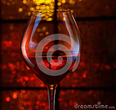 Holiday lights and wineglass