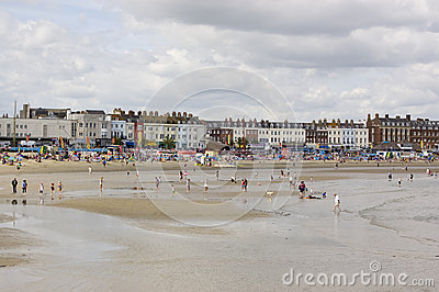 Holiday makers on Weymouth Beach Editorial Photography
