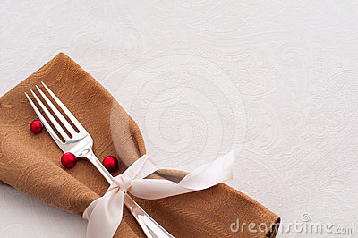 Holiday Place Setting on White Tablecloth