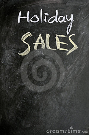 Holiday sales written on a blackboard