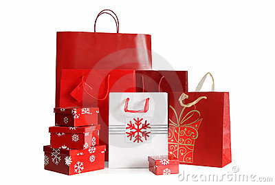 Holiday shopping bags and gift boxes on white