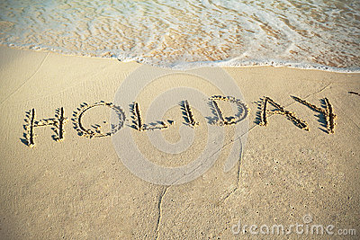 Holiday sign on the beach of Caribbean Sea