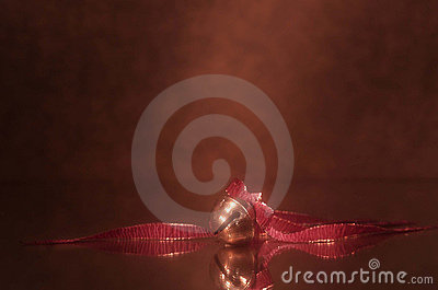 Holiday sleigh bell with red ribbon