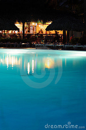 Holiday vacation resort pool bar at night