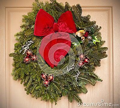 Holiday wreath hanging on a door