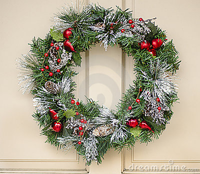 Holiday wreath hanging on door