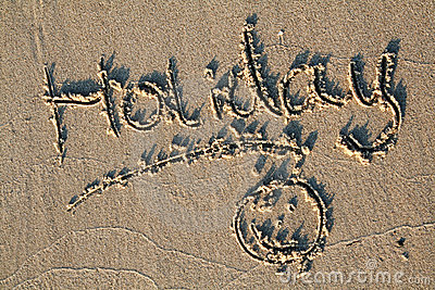 Holiday written in sand