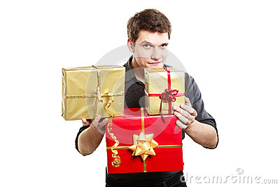 Holiday. Young man giving presents gifts boxes Stock Photo