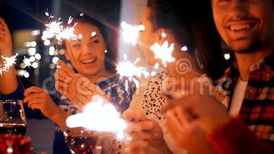 Friends with sparklers at home christmas dinner stock footage