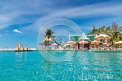 Holidays at tropical swimming pool