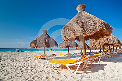 Holidays under parasol on Caribbean beach