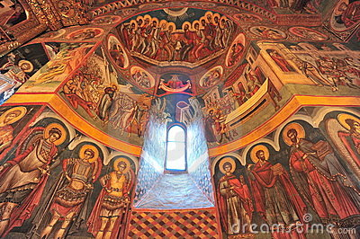 Holly light revealing interior icons of the church