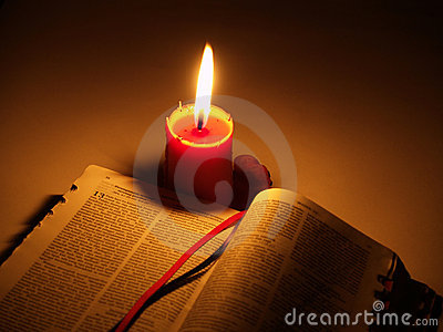 Holy Bible and Candle