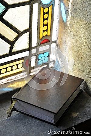 Holy bible on window