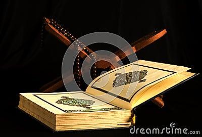 Holy islamic book Koran opened with rosary