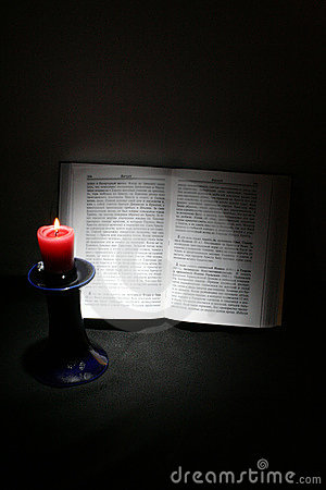 Holy Scriptures and candle