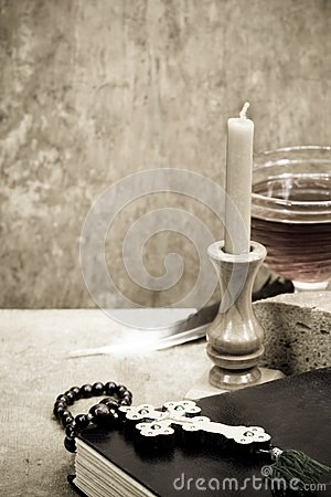 Holy Scriptures, candle and vine