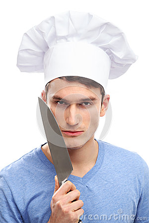 Hombre con el sombrero y los cuchillos del cocinero