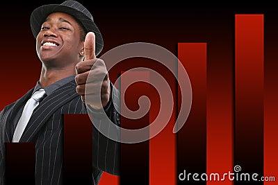 Hombre de negocios con el pulgar para arriba sobre antecedentes de levantamiento del gráfico