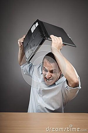 http://thumbs.dreamstime.com/x/hombre-de-negocios-enojado-que-rompe-su-computadora-port%C3%A1til-21042759.jpg