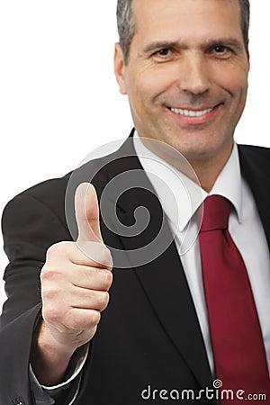 Hombre de negocios que muestra la muestra del thumbs-up