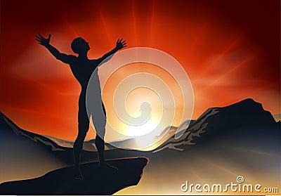 Hombre en la cima de la montaña con los brazos hacia fuera
