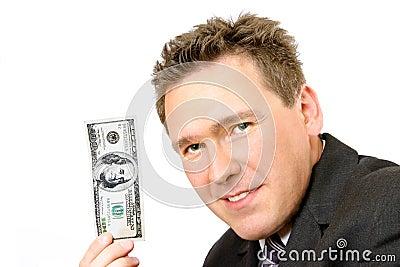 Hombre que lleva a cabo 100 dólares de Bill