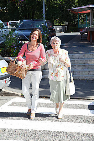 Home carer with elderly person in town