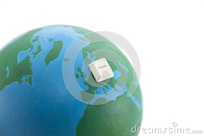 Home computer key on an earth globe