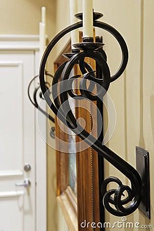 Home corridor with decorative metal details.
