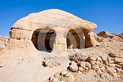 HOME de pedra da caverna em Bab como-Siq em PETRA