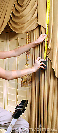 Home Decorating, Woman Measuring For New Curtains with Metal Tap