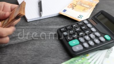 Home finances, investment, economy, saving money or insurance concept. Hands closeup. Female accountant or banker making calculati. Ons. Cash money calculation stock video