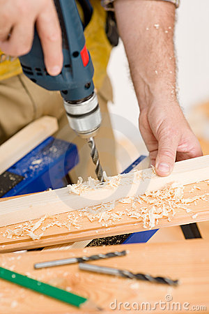 Home improvement - handyman drilling wood