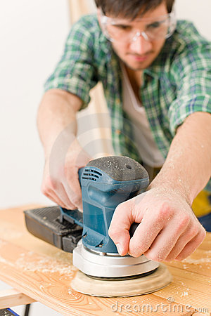 Home improvement - handyman sanding wooden floor